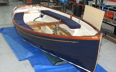 Super Yacht tender, Awlgrip paint with gold leaf cove line